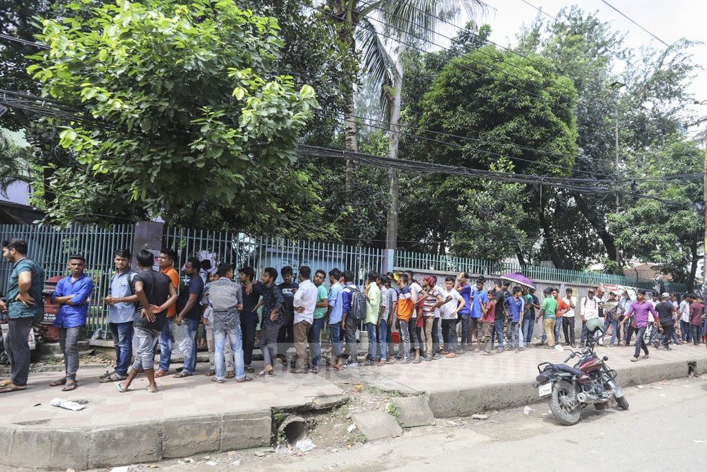 People line up at the Sher-e-Bangla National Cricket Stadium in Mirpur on Tuesday as cricket lovers wait to buy tickets to the final match of the tri-nation T20 series between Bangladesh and Afghanistan. Photo: Asif Mahmud Ove