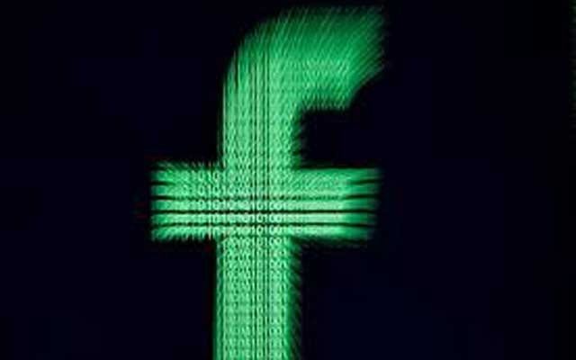A 3D-printed Facebook logo is displayed in front of binary digits in this illustration taken, March 18, 2018. REUTERS