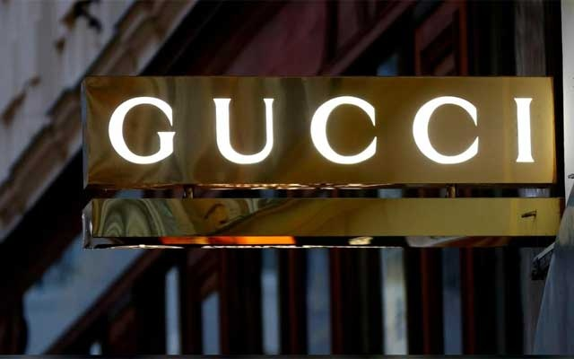 FILE PHOTO: A company logo is pictured outside a Gucci store in Vienna, Austria, May 4, 2016. REUTERS