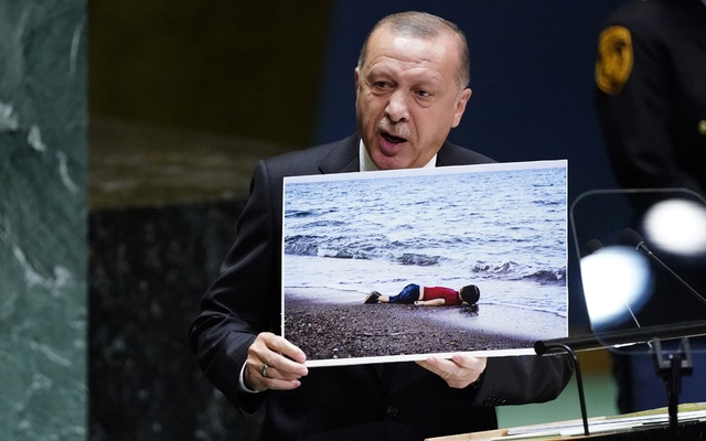 Turkey's President Recep Tayyip Erdogan holds up a photograph as he addresses the 74th session of the United Nations General Assembly at UN headquarters in New York City, New York, US, September 24, 2019. REUTERS/Carlo Allegri