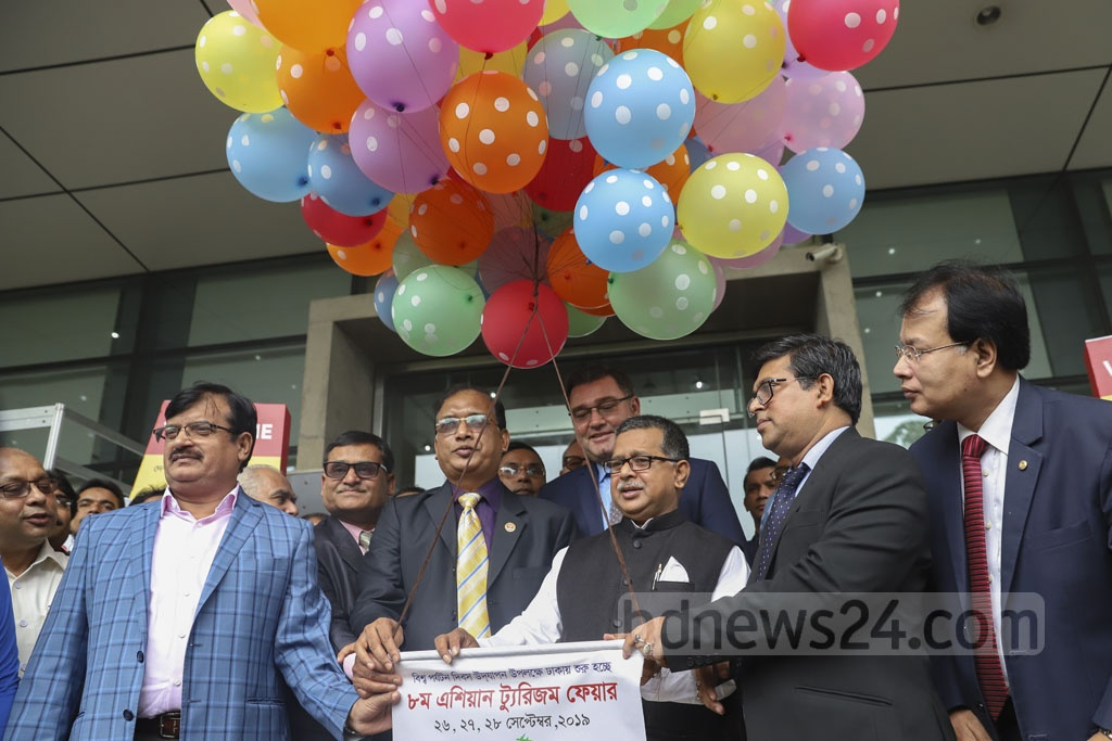 State Minister for Civil Aviation and Tourism Md Mahbub Ali inaugurates the 8th Asian Tourism Fair by cutting ribbons on Thursday at International Convention City Bashundhara, Dhaka. Photo: Abdullah Al Momin