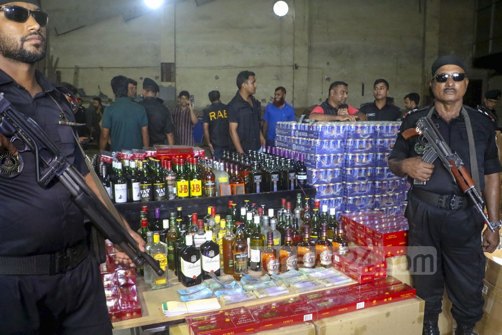 The Rapid Action Battalion seized many bottles of alcohol, cans of beer and cash in a raid on Fu-Wang Club in Tejgaon as part of an ongoing crackdown in Dhaka.
