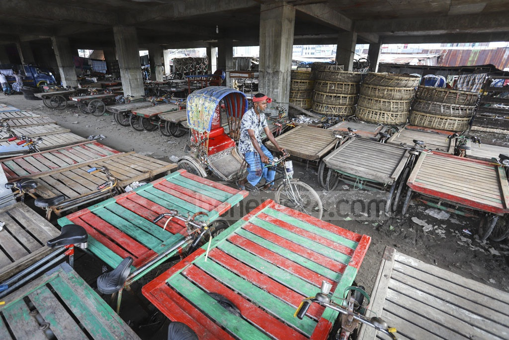 Rickshaws and rickshaw-vans are kept in a DSCC building constructed for a kitchen market in Jatrabari. Photo: Asif Mahmud Ove