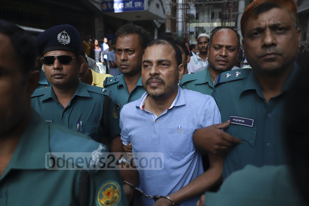 Police taking expelled Jubo League leader Khaled Mahmud Bhuiyan to a court that granted the law enforcers 10 more days to grill him in custody in two cases over drugs and illegal arms charges on Friday. Photo: Abdullah Al Momin