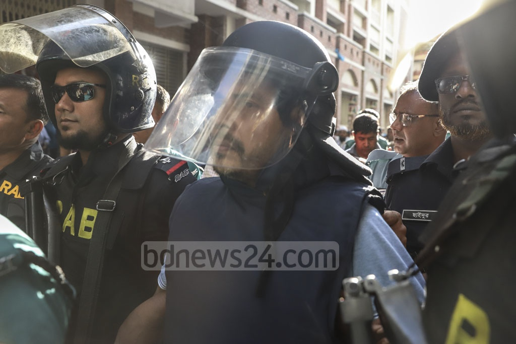 RAB personnel taking expelled Jubo League leader Khaled Mahmud Bhuiyan from a court that granted the law enforcers 10 more days to grill him in custody in two cases over drugs and illegal arms charges on Friday. Photo: Abdullah Al Momin