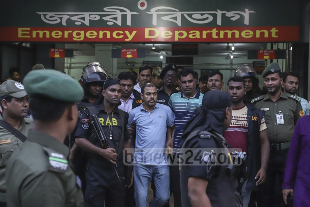 RAB personnel took expelled Jubo League leader Khaled Mahmud Bhuiyan to the Dhaka Medical College Hospital for a check-up after a court granted the law enforcers 10 more days to grill him in custody in two cases over drugs and illegal arms charges on Friday. Photo: Abdullah Al Momin