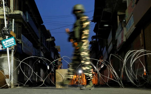 An Indian security force personnel stands guard in a street early morning during restrictions following scrapping of the special constitutional status for Kashmir by the Indian government, in Srinagar, September 27, 2019. Reuters