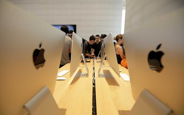 People look at products during the opening of Mexico's first flagship Apple store at Antara shopping mall in Mexico City, Mexico Sep 27, 2019. REUTERS