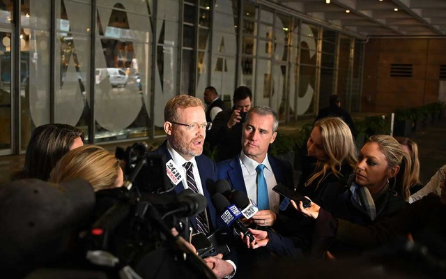 File Photo: Craig McMurtrie, center left, the Australian Broadcasting Corporation's editorial director, speaking to reporters as the police raided the public broadcaster's headquarters in Sydney in June. The New York Times