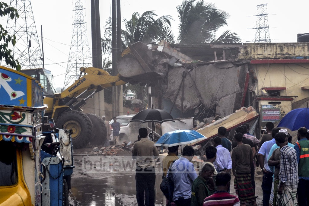 Dhaka North City Corporation demolished illegal structures in a drive on Dhaka's Gabtoli on Tuesday.