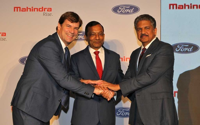 Jim Farley, President of Ford New Businesses, Technology & Strategy, Pawan Goenka, Managing Director of Mahindra & Mahindra Limited, and Anand Mahindra, Chairman of Mahindra Group, join their hands after attending a news conference in Mumbai, India, October 1, 2019. Reuters