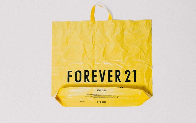 "Forever 21's shopping bag with ""John 3:16,"" a reference to the Bible verse, printed on it in New York, Sept. 28, 2019. Forever 21, the California retailer that helped popularise fast fashion in the United States said it plans to file for bankruptcy and will close up to 182 stores in the United States and up to 350 over all. (Haruka Sakaguchi/The New York Times)"