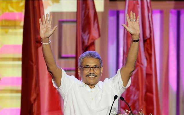 FILE PHOTO: Sri Lanka's former defense secretary Gotabaya Rajapaksa waves after he was nominated as a presidential candidate during the Sri Lanka People's Front party convention in Colombo, Sri Lanka Aug 11, 2019. REUTERS