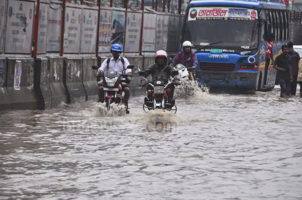 Hours of incessant rains left many parts of Dhaka inundated, including Motijheel, Paltan, Zero Point and several neighbouring areas, which disrupted traffic. This photo was taken at the capital's Topkhana Road on Tuesday.