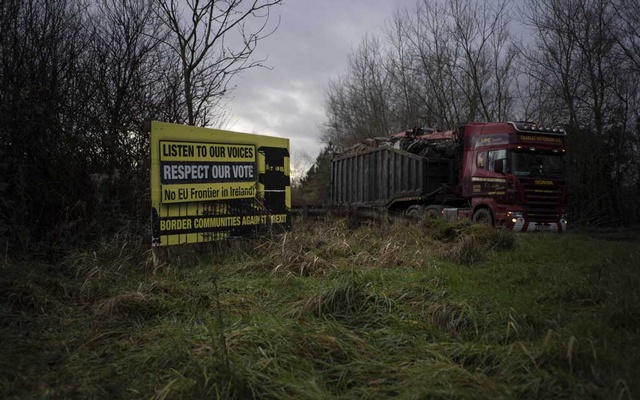 FILE PHOTO: An anti-Brexit sign near the border between Northern Ireland and the Republic of Ireland, Dec 19, 2018. With time running out for a deal on Brexit, the Irish government and European Union officials have rejected the latest British thinking on how to resolve an impasse over the Irish border as of Oct 1, 2019, a serious setback to prospects for a breakthrough. The New York Times