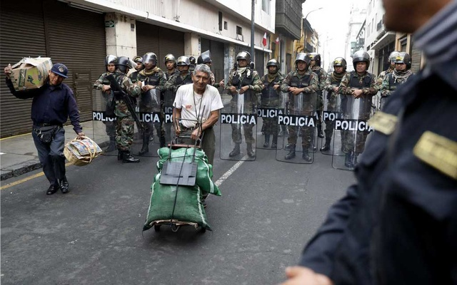 Police near Peru's Congress, in Lima, on Tuesday. The New York Times
