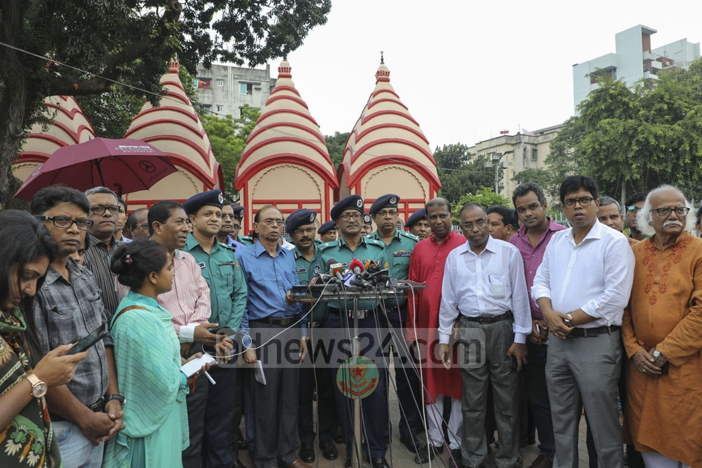 DMP Commissioner Shafiqul Islam speaking to reporters after inspecting security measures at the Dhakeshwari National Temple in Dhaka on the occasion of Durga Puja on Thursday.