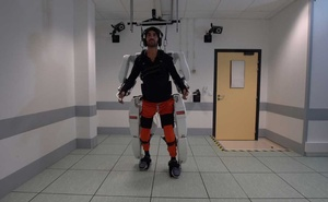 A patient with tetraplegia walks using an exoskeleton in Grenoble, France, in February 2019, in this still image taken from a video handout. Fonds De Dotation Clinatec/La Breche/Handout via REUTERS