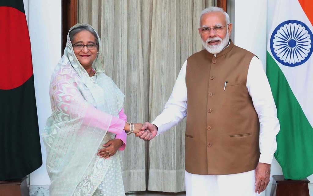 Prime Minister Sheikh Hasina shakes hands with her Indian counterpart Narendra Modi before a bilateral meeting at the Hyderabad House in New Delhi on Saturday. Photo: PID