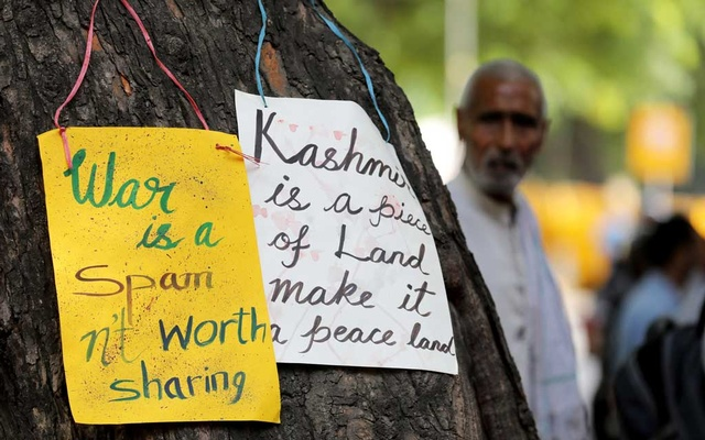 FILE PHOTO: Placards with messages are hung on a tree at a protest against warmongering in New Delhi, India, Sep 27, 2019. REUTERS