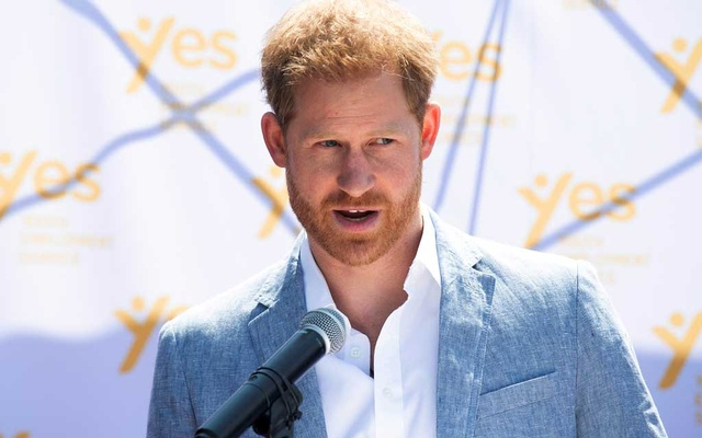 FILE PHOTO: Britain's Prince Harry, the Duke of Sussex, speaks at the Youth Employment Services (YES) Hub as he and his wife Meghan, the Duchess of Sussex, visit a township in Johannesburg, South Africa, Oct 2, 2019. Reuters