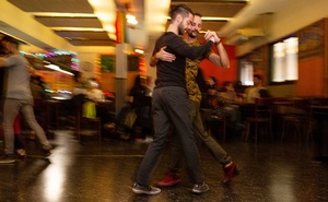 Esteban Mioni and Pablo Ciarrocchi dance the tango at the El Despelote bar in Buenos Aires, Argentina, Jul 1, 2019. The New York Times