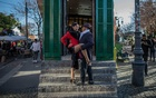Julia Hernandez, who earns her living posing for tango-themed photographs with tourists, strikes a classic pose in the El Caminito district of Buenos Aires, Argentina, Jul 6, 2019. A group of activists is trying to make tango less dogmatic about traditional gender roles, and more assertive about rooting out sexual harassment and assault. The New York Times