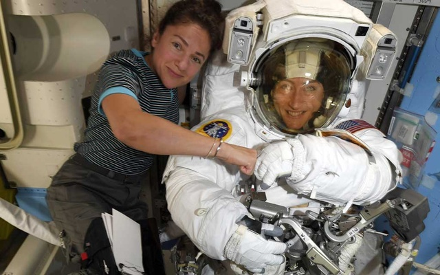 In an image provided by NASA, astronauts Jessica Meira, left, and Christina Koch on the International Space Station. The first spacewalk to be conducted entirely by women is scheduled for Oct 21, 2019, NASA announced, nearly seven months after an all-female spacewalk was cancelled because two properly fitted spacesuits were not readily available. The New York Times