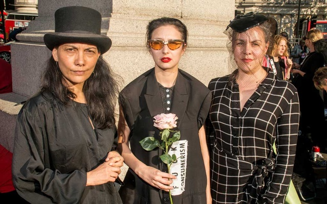 From left: Bel Jacobs, Sara Arnold and Alice Wilby, the coordinators of the BoycottFashion movement and part of Extinction Rebellion, or XR, at Trafalgar Square before marching in an XR protest of fashion during London Fashion Week, Sep 17, 2019. The New York Times