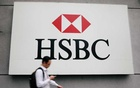 A man walks past a logo of HSBC at its headquarters in Kuala Lumpur, Malaysia August 6, 2019. Reuters