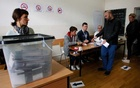 Voting at a polling station in the northern part of the ethnically divided city of Mitrovica, Kosovo, on Sunday. The New York Times