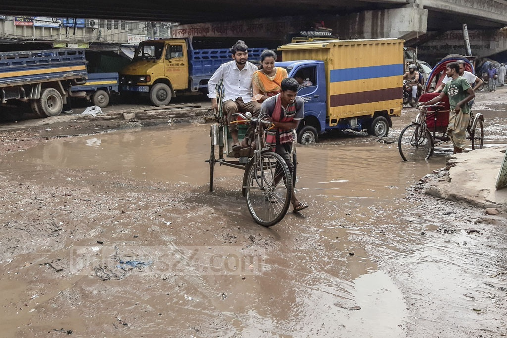 The prolonged water-logging causes several accidents almost every day on a key road through the capital's Armanitola beneath Nayabazar Bridge. Photo: Abdullah Al Momin
