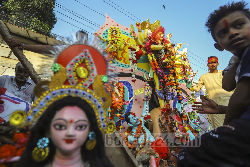 Idols of Goddess Durga were brought to Dhaka's Waizghat from different Mandaps for immersion in the Buriganga river on Tuesday. Photo: Asif Mahmud Ove