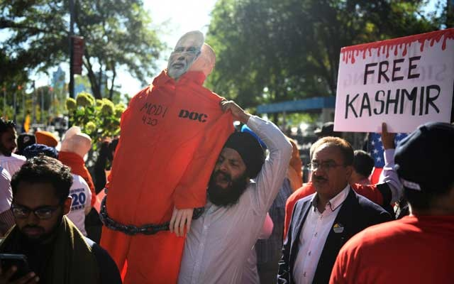 A man holds a cardboard cutout of the Prime Minister of India Narendra Modi wearing a prison jumpsuit during a protest in solidarity with the people of Kashmir on the sidelines of the United Nations General Assembly in New York, US, Sep 27, 2019. REUTERS