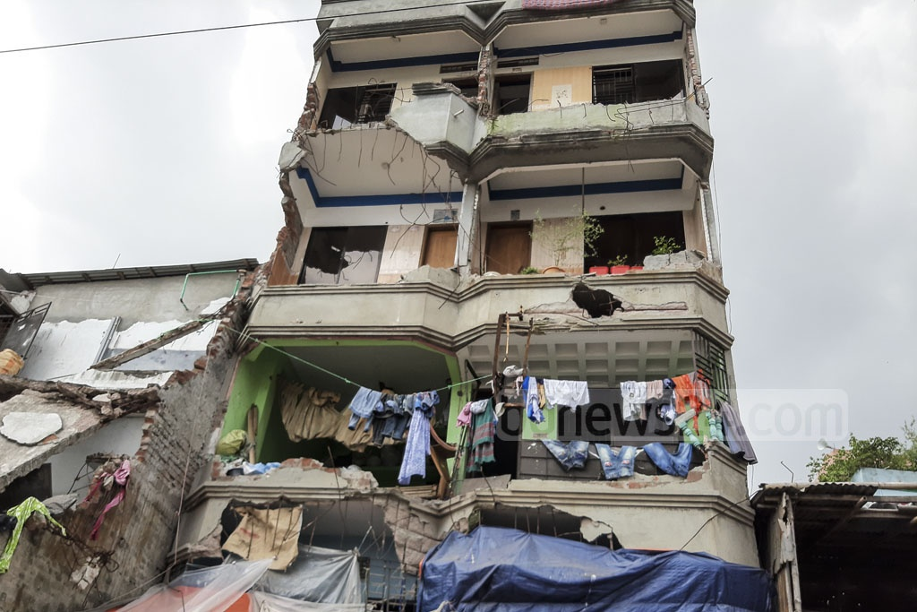 Residents continue to jeopardise their lives at risk by living in buildings that were partially-demolished in an eviction drive by BIWTA on the banks of the Buriganga River in Old Dhaka's Islambag after . Photo: Abdullah Al Momin