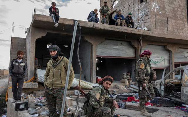 Syrian Democratic Forces fighters in Baghouz, Syria, Feb 2, 2019.  The New York Times