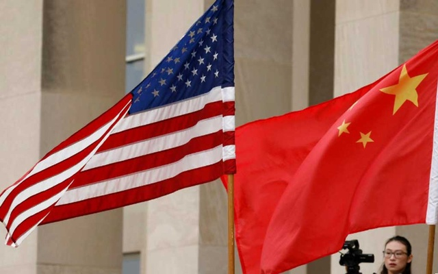 FILE PHOTO: US and Chinese flags are seen before Defence Secretary James Mattis welcomes Chinese Minister of National Defence Gen Wei Fenghe to the Pentagon in Arlington, Virginia, US, Nov 9, 2018. REUTERS