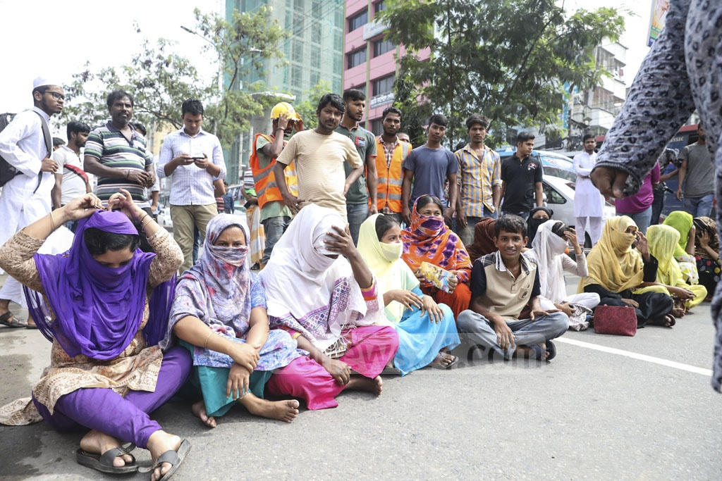 Workers of garment maker Air Fashion blocking the capital's Rampura-Malibagh road on Thursday to demand three months' worth of outstanding wages.