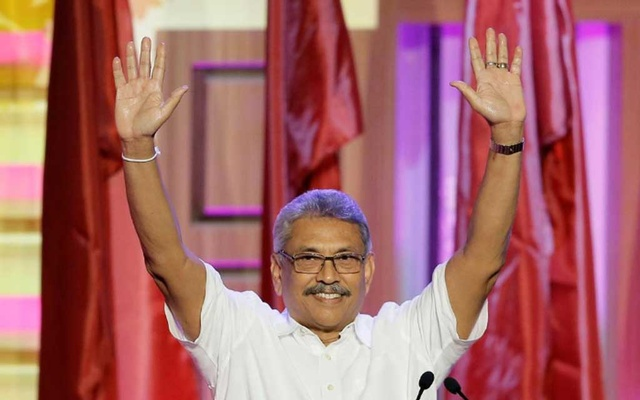 FILE PHOTO: Sri Lanka's former defense secretary Gotabaya Rajapaksa waves after he was nominated as a presidential candidate during the Sri Lanka People's Front party convention in Colombo, Sri Lanka August 11, 2019. REUTERS