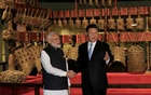 FILE PHOTO: Chinese President Xi Jinping and Indian Prime Minister Narendra Modi shake hands as they visit the Hubei Provincial Museum in Wuhan, Hubei province, China April 27, 2018. China Daily via REUTERS