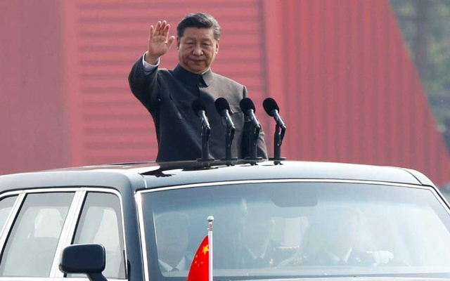 FILE PHOTO: Chinese President Xi Jinping waves from a vehicle as he reviews the troops at a military parade marking the 70th founding anniversary of People's Republic of China, China October 1, 2019. REUTERS