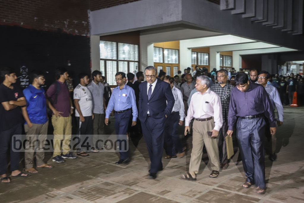 BUET VC Saiful Islam and other teachers leaving the auditorium after meeting student Abrar Fahad murder protesters on Friday. Photo: Abdullah Al Momin