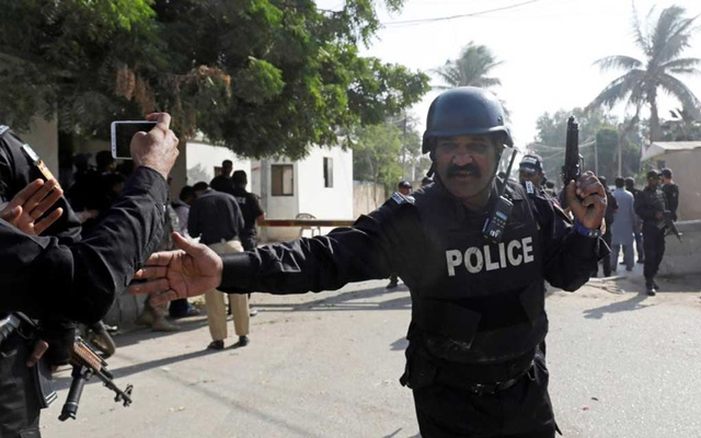 File Photo: A Police officer stops people which take pictures with their cell phones, after an attack on the Chinese consulate, in Karachi, Pakistan Nov 23, 2018. REUTERS