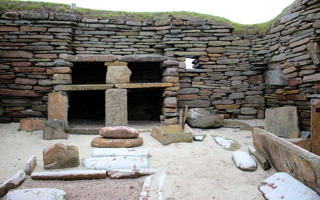 FILE PHOTO: Neolithic Buildings are seen at Skara Brae in the Orkney Islands, Scotland Britain Sep 25, 2019. REUTERS