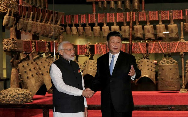 Chinese President Xi Jinping and Indian Prime Minister Narendra Modi shake hands as they visit the Hubei Provincial Museum in Wuhan, Hubei province, China April 27, 2018. China Daily via REUTERS