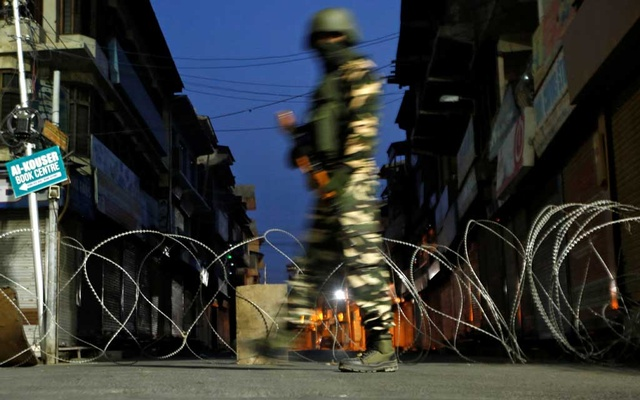 File Photo: An Indian security force personnel stands guard in a street early morning during restrictions following scrapping of the special constitutional status for Kashmir by the Indian government, in Srinagar, Sep 27, 2019. REUTERS