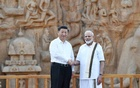 China's President Xi Jinping shakes hand with India's Prime Minister Narendra Modi during their visit to Arjuna's Penance in Mamallapuram on the outskirts of Chennai, India, Oct 11, 2019. REUTERS