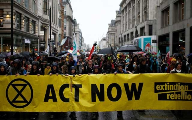 Climate change activists attend an Extinction Rebellion demonstration in London, Britain, Oct 12, 2019. REUTERS