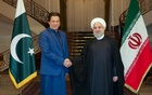 FILE PHOTO: Iranian President Hassan Rouhani shakes hands with Pakistani Prime Minister Imran Khan in Tehran, Iran, October 13, 2019. Official Presidential website/Handout via REUTERS