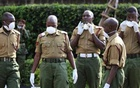 Kenyan police officers wait to receive bodies of colleagues killed in an ambush by cattle raiders in a remote northern region, at the Chiromo University Mortuary in Nairobi November 13, 2012. REUTERS